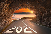 istock 2021 year with light at the end of the tunnel 1230715722