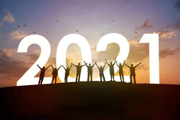 2021 year with team together Silhouette Group of people rise arm up with 2021 and beautiful sunset background. New year success, Believe and team together concept. new years day stock pictures, royalty-free photos & images
