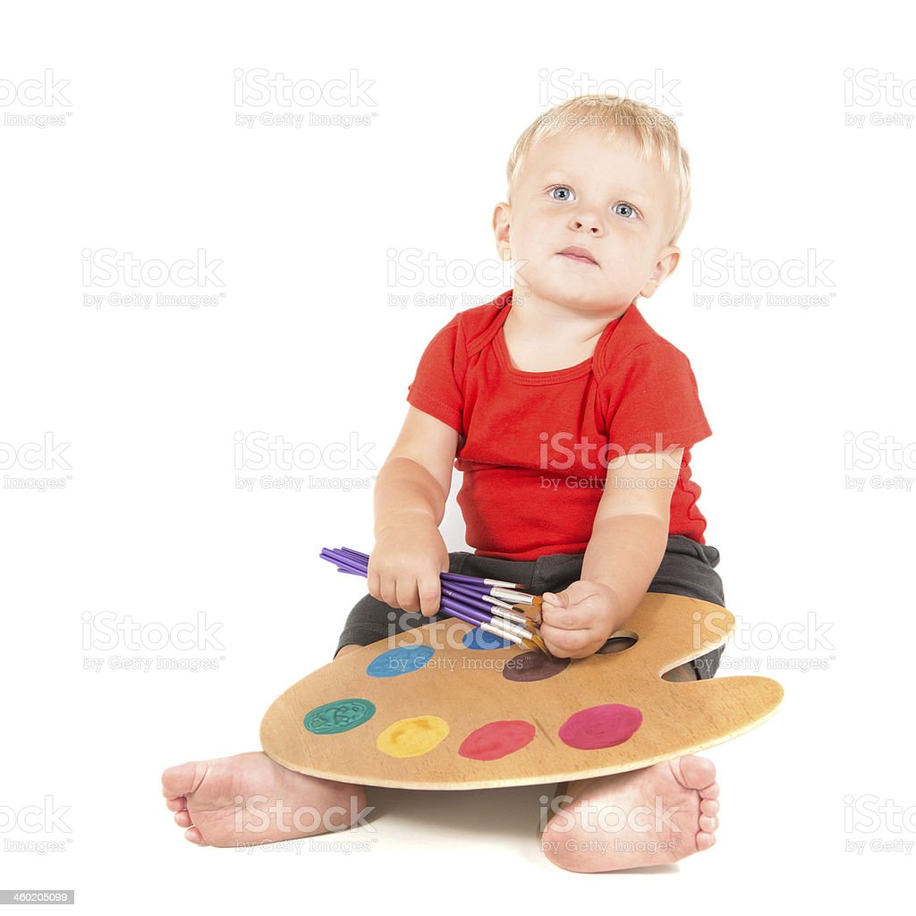 year-old child as small artist with paint brushes and  palette royalty-free stock photo