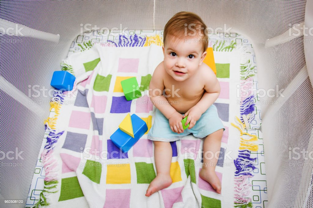 A year-old child is sitting in an arena stock photo