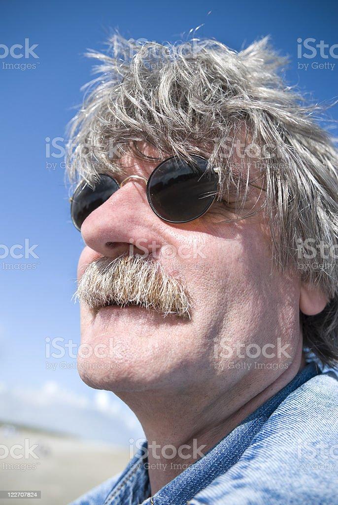 50 year-old man, grey hair, sunglasses, low angle portrait stok fotoğrafı