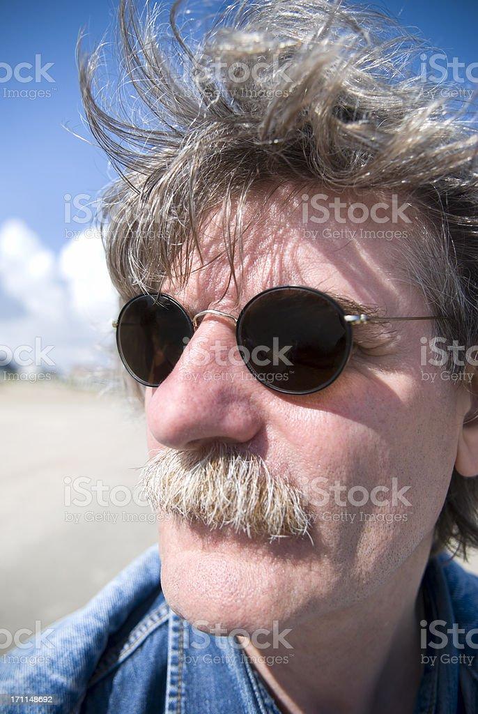50 year-old man, grey hair, sunglasses, wide-angle portrait stok fotoğrafı