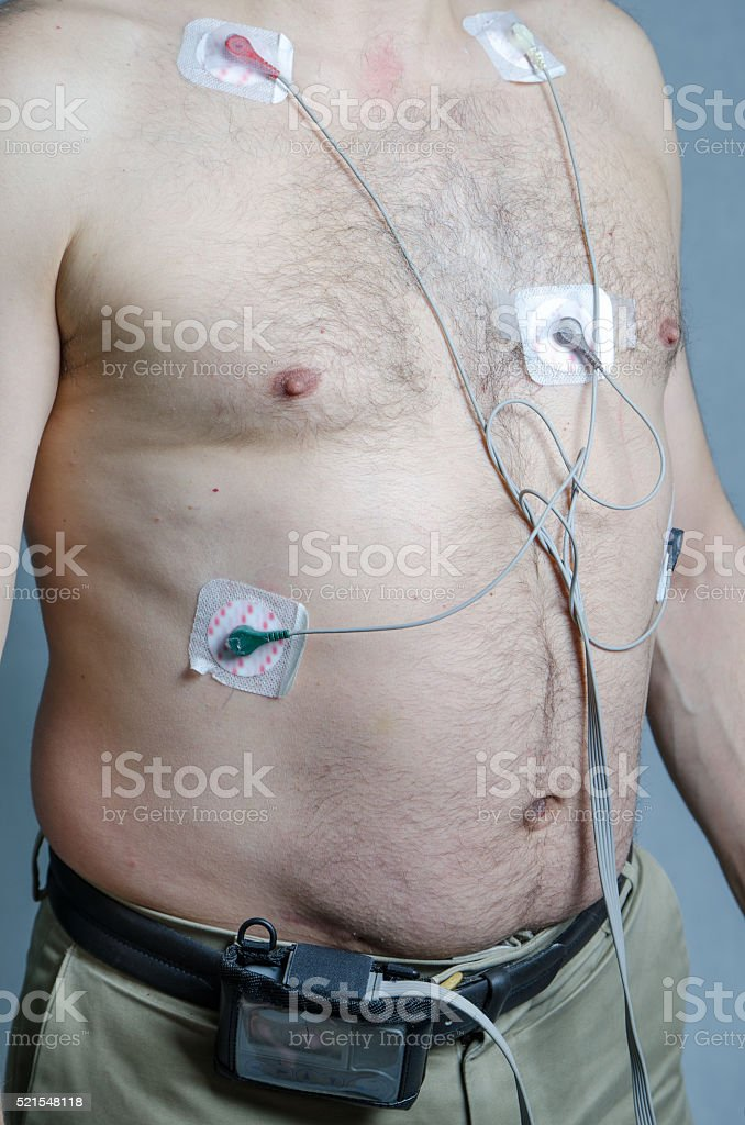 50 year-old man with 5 sensors with holter monitor stok fotoğrafı