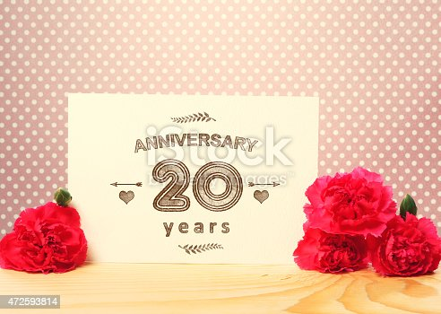 istock 20 years anniversary card with pink carnations 472593814