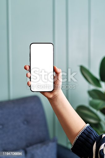 6-7 years child holding and touching smart phone. Smart phone screen with clipping path.