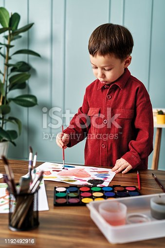 123500924 istock photo 2-3 years child painting with watercolor at home. 1192492916