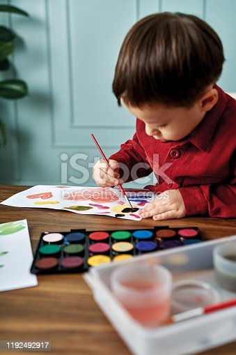 123500924 istock photo 2-3 years child painting with watercolor at home. 1192492917