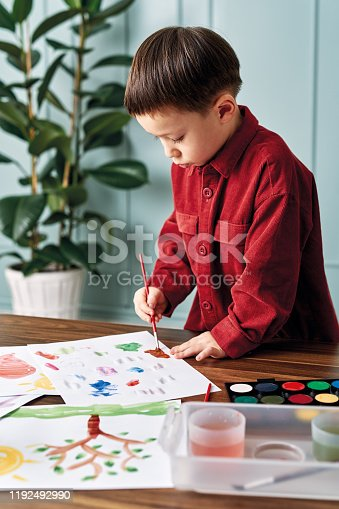 123500924 istock photo 2-3 years child painting with watercolor at home. 1192492990