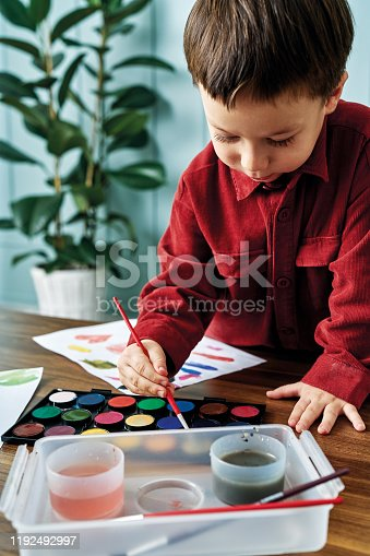 123500924 istock photo 2-3 years child painting with watercolor at home. 1192492997