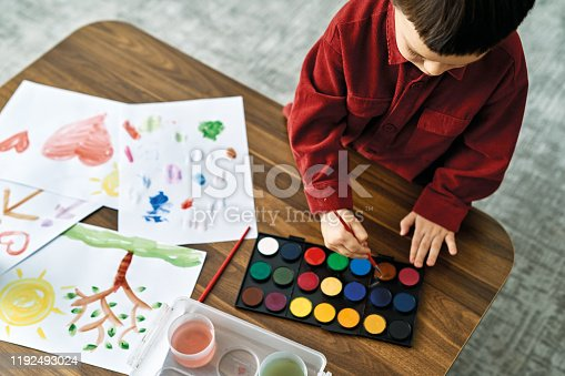 123500924 istock photo 2-3 years child painting with watercolor at home. 1192493024