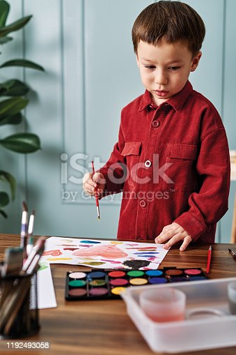 123500924 istock photo 2-3 years child painting with watercolor at home. 1192493058