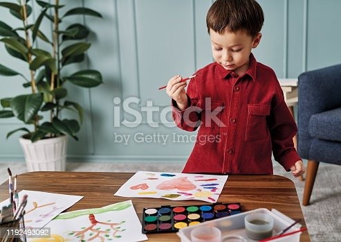 123500924 istock photo 2-3 years child painting with watercolor at home. 1192493092