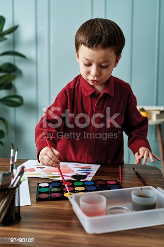 123500924 istock photo 2-3 years child painting with watercolor at home. 1192493102