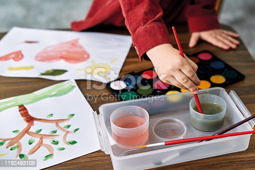 123500924 istock photo 2-3 years child painting with watercolor at home. 1192493105