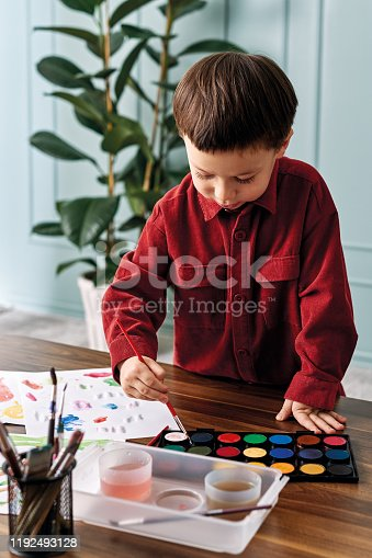 123500924 istock photo 2-3 years child painting with watercolor at home. 1192493128