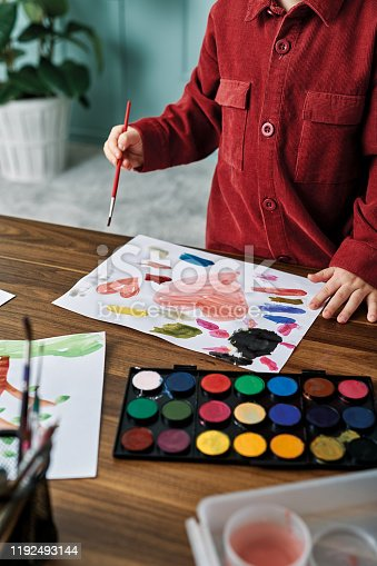 123500924 istock photo 2-3 years child painting with watercolor at home. 1192493144