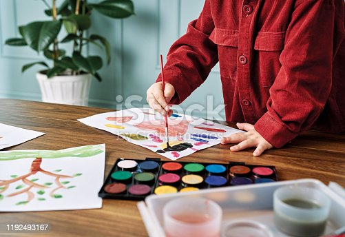 123500924 istock photo 2-3 years child painting with watercolor at home. 1192493167