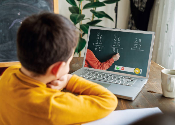 6-7 years cute child learning mathematics from computer. 6-7 years cute child learning mathematics from computer. elementary age stock pictures, royalty-free photos & images