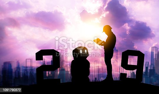 istock 2019 years of ai automation robot technology , industry 4.0 , artificial intelligence trend concept. Silhouette of automation robot arms. Vivid twilight sunset sky background. 1091790372