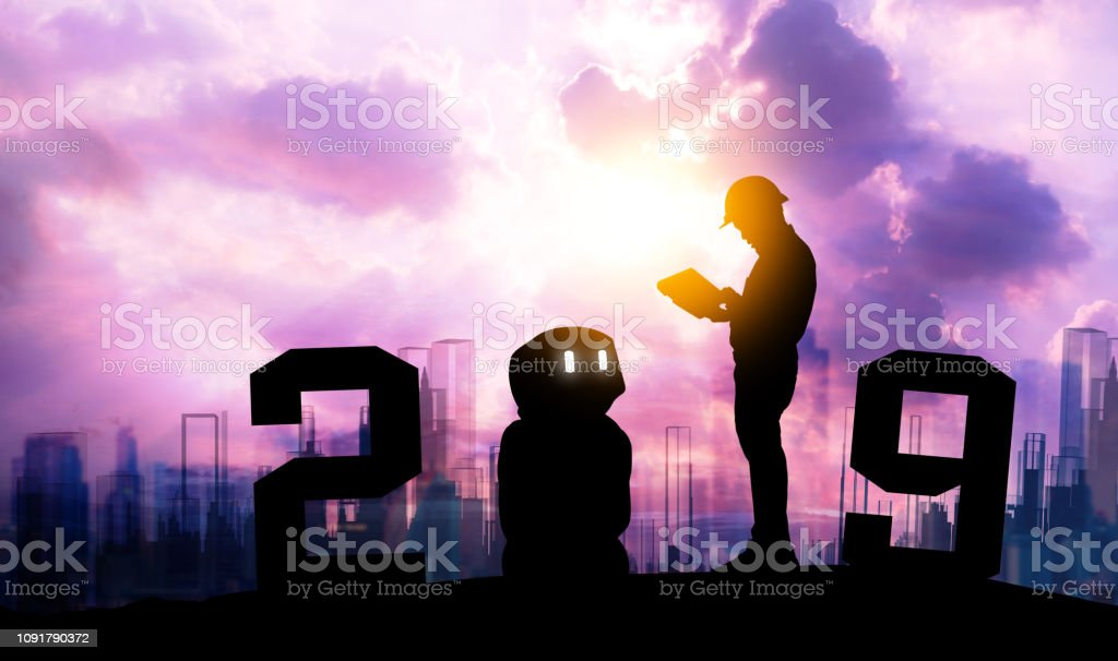 2019 years of ai automation robot technology , industry 4.0 , artificial intelligence trend concept. Silhouette of automation robot arms. Vivid twilight sunset sky background. stock photo