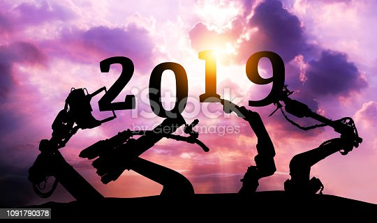 istock 2019 years of ai automation robot technology , industry 4.0 , artificial intelligence trend concept. Silhouette of automation robot arms. Vivid twilight sunset sky background. 1091790378