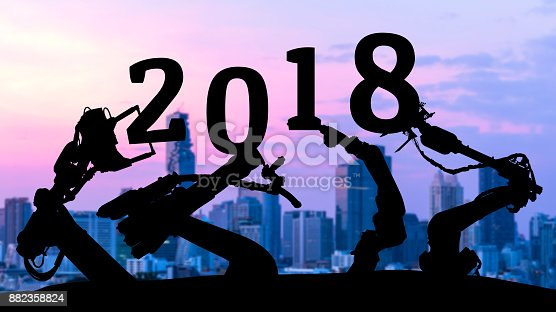 istock 2018 years of ai technology , industry 4.0 , artificial intelligence trend concept. Silhouette of automation robot arms. Blur metropolis city building background. 882358824