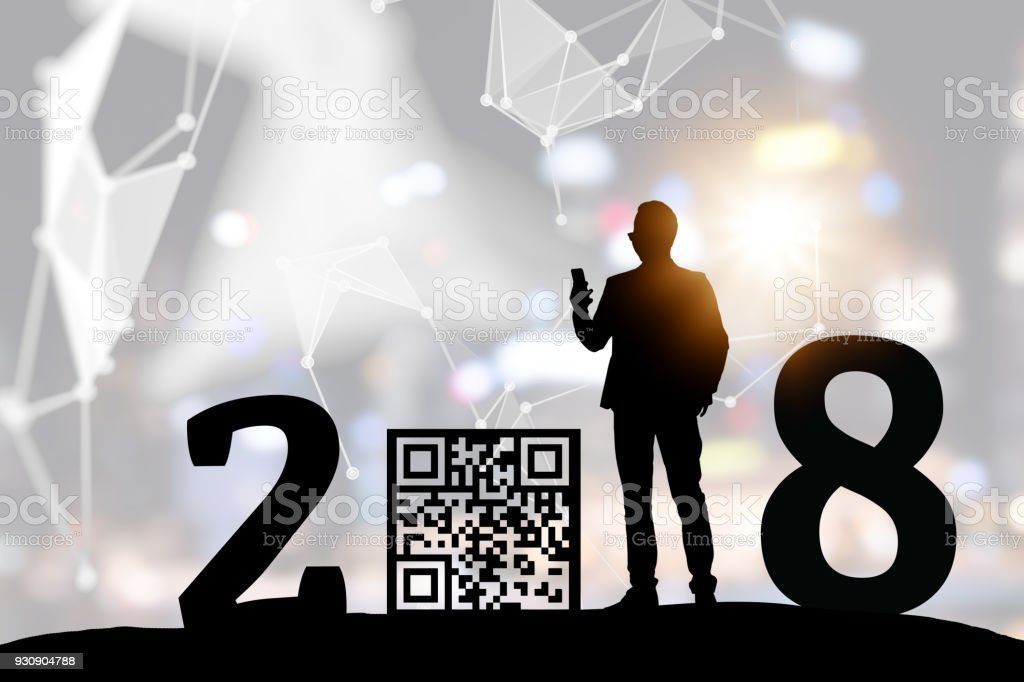 2018 years of Qr code payment , online shopping , cashless technology trend concept. Silhouette of business man scanning digital pay code without money   note. Bokeh flare light effect background. stock photo