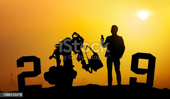 1042088340 istock photo 2019 years of robot assistant technology , industry 4.0 , artificial intelligence trend concept. Silhouette of business man control automation robo advisor arm with sunrise logistic bakckground. 1086243478