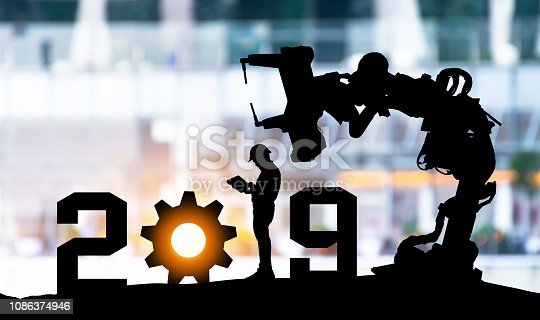 1091790372 istock photo 2019 years of robot assistant technology , industry 4.0 , artificial intelligence trend concept. Silhouette of business man control automation robo advisor arm in blur smart building bakckground. 1086374946