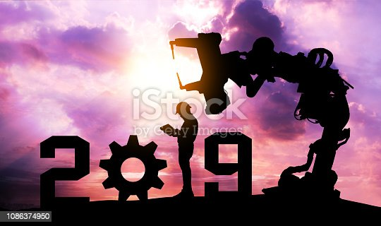 istock 2019 years of robot assistant technology , industry 4.0 , artificial intelligence trend concept. Silhouette of business man control automation robo advisor arm with sunrise logistic bakckground. 1086374950