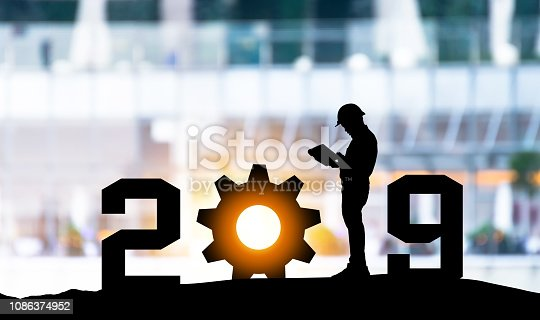istock 2019 years of robot assistant technology , industry 4.0 , artificial intelligence trend concept. Silhouette of engineer man control automation robo advisor gear in blur smart building bakckground. 1086374952