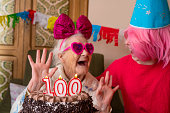 100 years old birthday cake to old woman elderly celebration with granddaughter