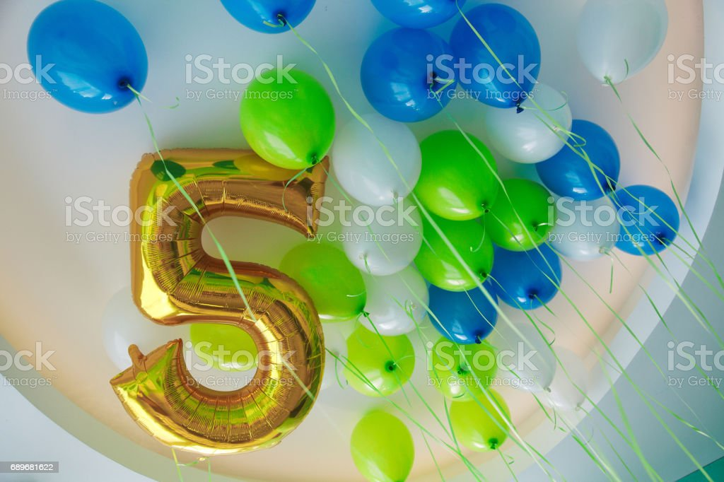 5 years old birthday decoration with balloons stock photo