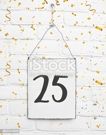 178269167istockphoto 25 years old birthday party card text with golden confetti, number twenty-five, metal plate white brick background 993404928