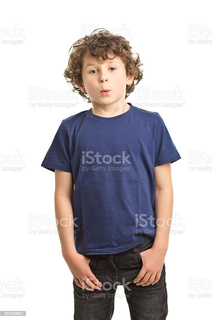 7 years old boy in tshirt whistling stock photo
