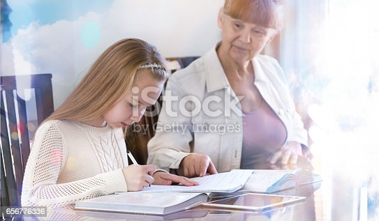 istock 10 years old girl and her teacher. Little girl study during her private lesson. 656776336