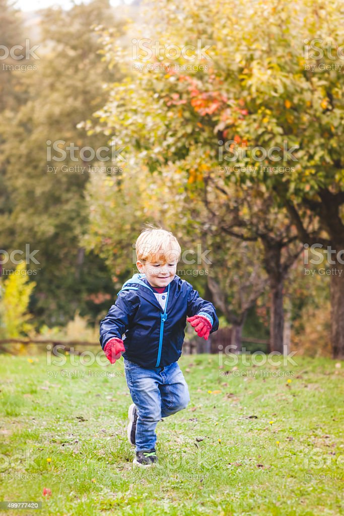 3 Years Old Kid Running at the Park stock photo