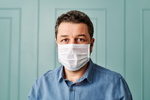 30-39 years old man wearing surgical mask.