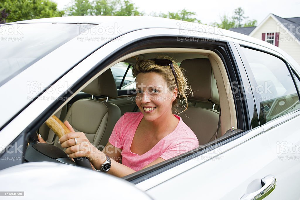 40 years old woman in a car royalty-free stock photo