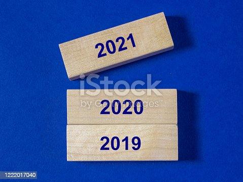 873333520 istock photo 2019 / 2020 / 2021 years on wooden blocks on dark blue background 1222017040