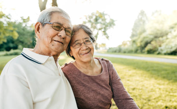 50 years together Seniors couple walking in the park filipino ethnicity stock pictures, royalty-free photos & images
