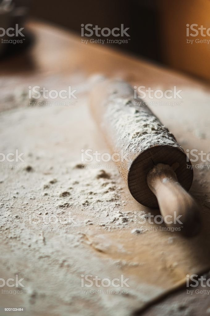 Yeast dough on the wooden table stock photo
