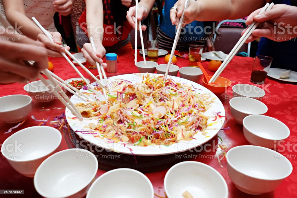 Yee Sang Chinese New Year dish for Prosperity Toss Dinner Celebration. Perfect menu image for your Restaurant or Hotel dinner course Yu Sheng Happy Lunar New Year 2018. stock photo