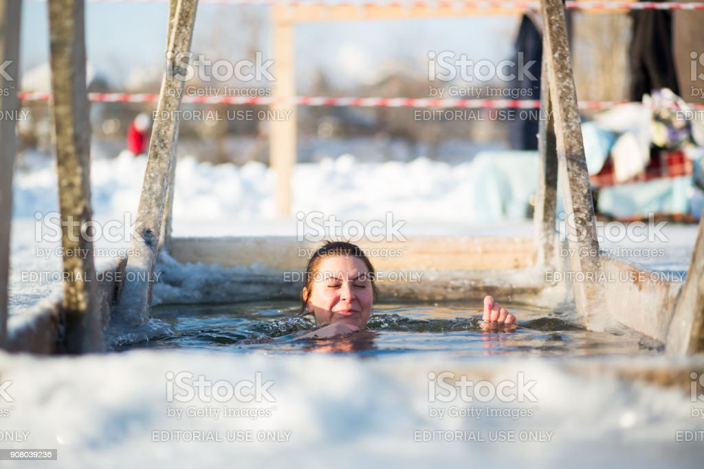 Yekaterinburg, Russia January 19, 2018 - Swimming in the hole of young girls on Lake Shartash on the occasion of the Orthodox Christian holiday 'Baptism' stock photo