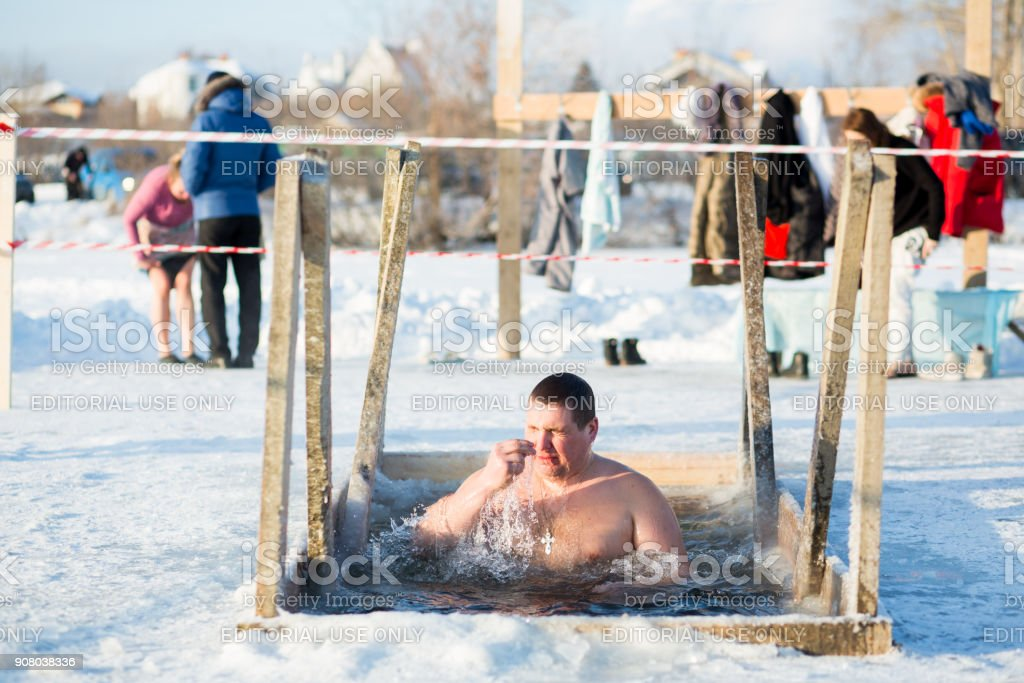 Yekaterinburg, Russia January 19, 2018 - Swimming in the ice hole on Lake Shartash on the occasion of the Orthodox Christian holiday 'Epiphany' stock photo