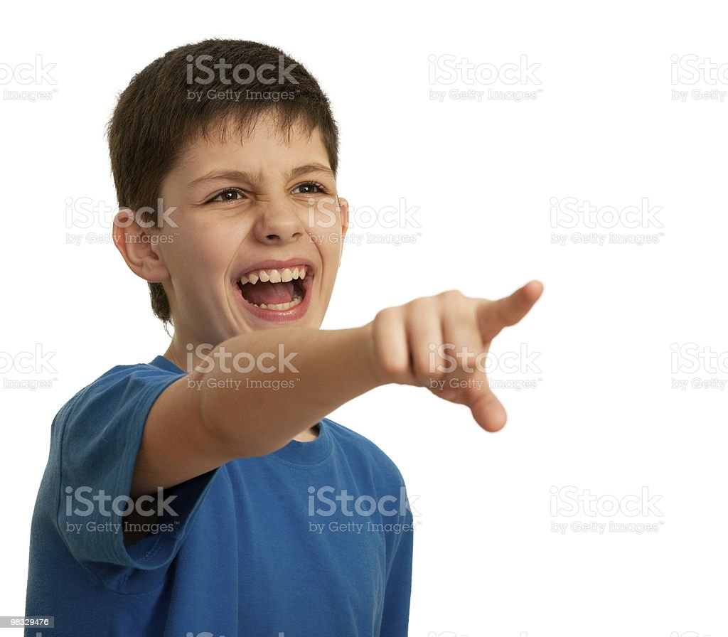 Yelling boy pointing forward royalty-free stock photo