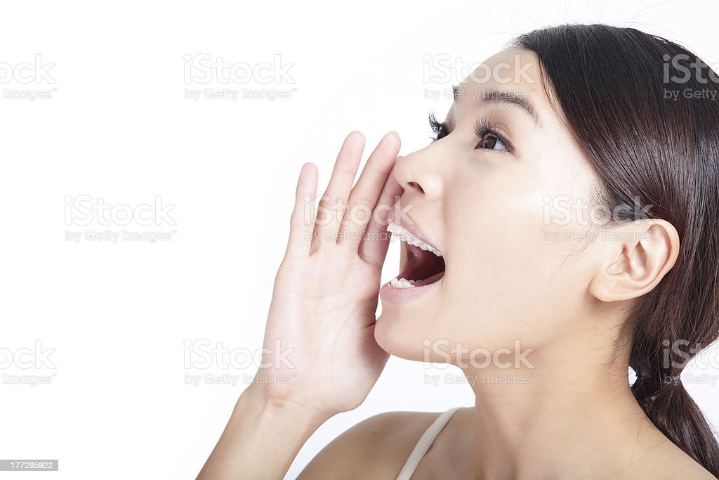 Yelling woman mouth closeup stock photo