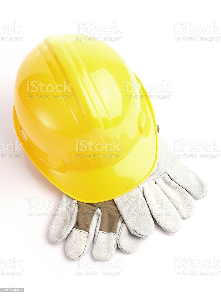Yelllow construction hat on gloves royalty-free stock photo