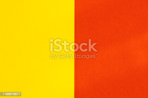 Yelllow red color paper background. Geometric figures, shapes. Abstract geometric flat composition. Empty space on monochrome cardboard