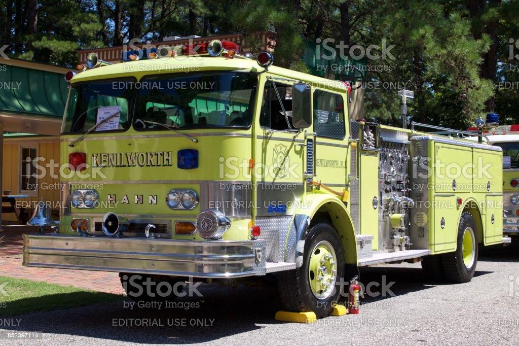 A yellow 1974 Hahn pumper fire truck stock photo